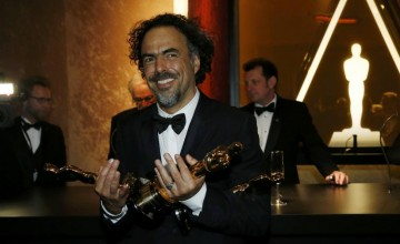 "Director Alejandro Gonzalez Inarritu poses with his Oscars for best picture, best director and best original screenplay for ""Birdman"" after they were engraved at the Governors Ball following the 87th Academy Awards in Hollywood"