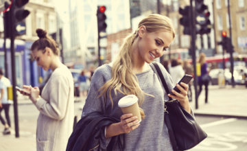 mobile_girl_in-street_istock
