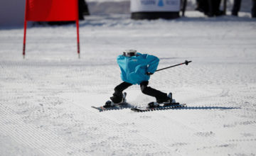 Robot Tae Kwon V skies during the Ski Robot Challenge at a ski resort in Hoenseong