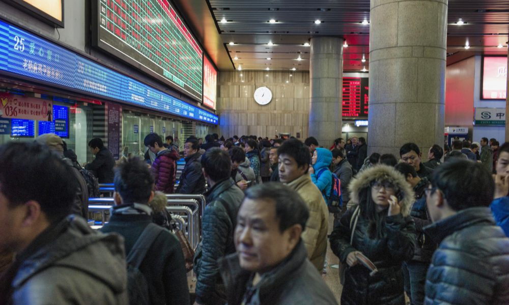 Chinese travelers queue to buy train tickets to head home for the Lunar New Year at the Beijing Train Station on February 4, 2015. China is preparing to welcome the Lunar New Year of Sheep which falls on February 19.  AFP PHOTO / FRED DUFOUR        (Photo credit should read FRED DUFOUR/AFP/Getty Images)
